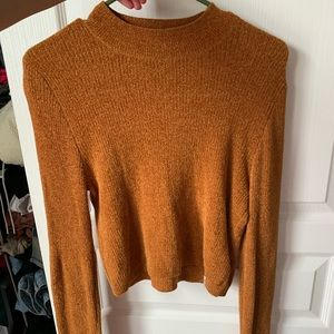 Mustard sweater in a size large